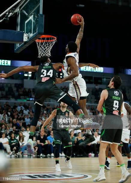 Keith Benson of the Phoenix defends Cameron Oliver of the Taipans as he attempts a huge dunks the ball during the round 11 NBL match between the...