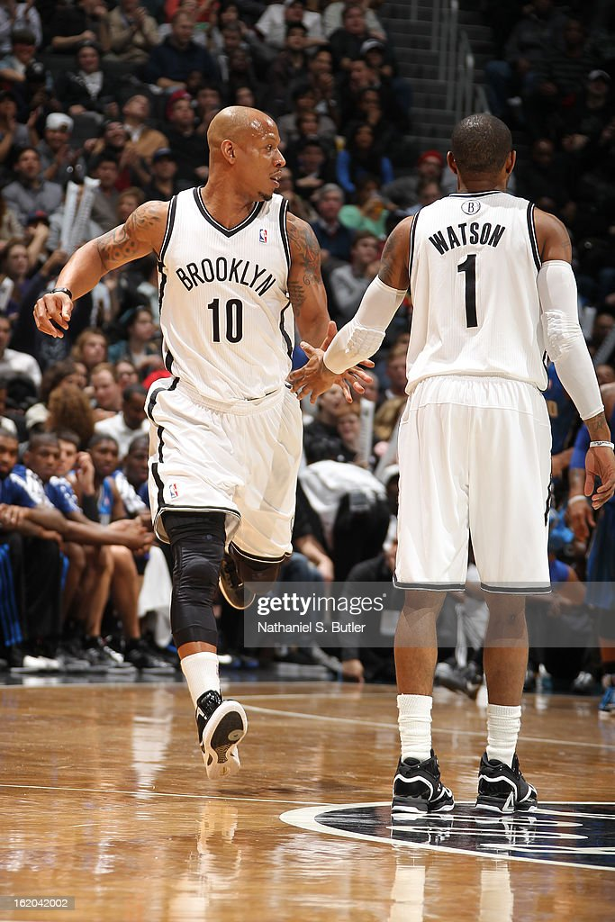 Keith Bogans #10 and C.J. Watson #1 of the Brooklyn Nets congradulate each other during the game against the Orlando Magic on January 28, 2013 at the Barclays Center in the Brooklyn borough of New York City.