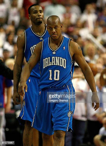 Keith Bogans and Rashard Lewis of the Orlando Magic walk off the court after they lost 9186 against the Detroit Pistons in Game Five of the Eastern...