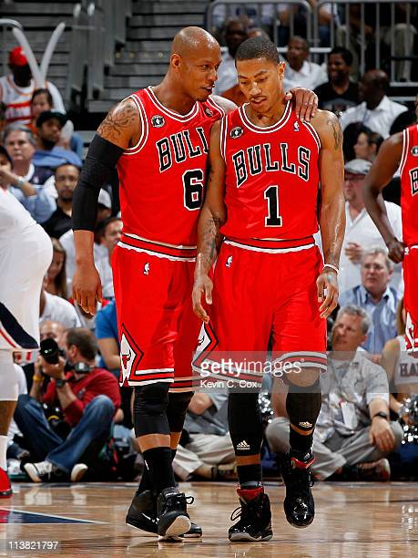 Keith Bogans converses with Derrick Rose of the Chicago Bulls after Rose drew a foul from the Atlanta Hawks in Game Three of the Eastern Conference...