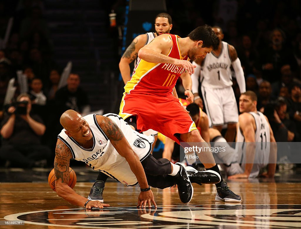 Keith Bogans #10 of the Brooklyn Nets and Carlos Delfino #10 of the Houston Rockets battle for the ball during their game at the Barclays Center on February 22, 2013 in the Brooklyn borough of New York City.