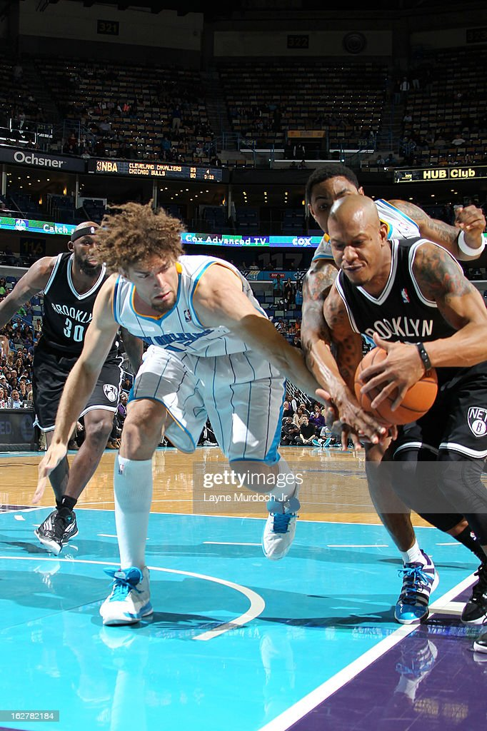 Keith Bogans #10 of the Brooklyn Nets battles for a loose ball against Robin Lopez #15 of the New Orleans Hornets on February 26, 2013 at the New Orleans Arena in New Orleans, Louisiana.