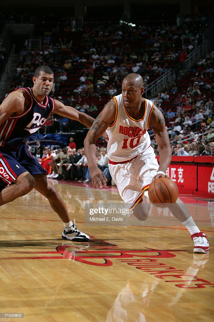 Keith Bogans #10 of the Houston Rockets drives around Shane Battier #31 of the Memphis Grizzlies during the game on April 15, 2006 at the Toyota Center in Houston, Texas. The Grizzlies won 93-81.