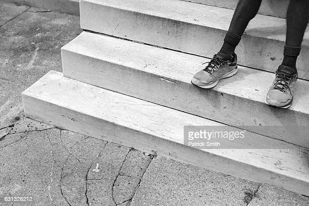 Keith Boissiere's rests his feet on his front steps on September 15 2016 in Baltimore Maryland A lean muscular figure the 'Running Man' weighs about...