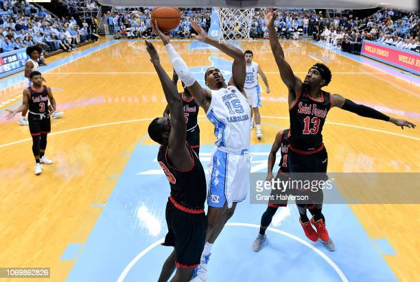 Keith Braxton of the St Francis Red Flash defends a shot by Garrison Brooks of the North Carolina Tar Heels during the second half of their game at...