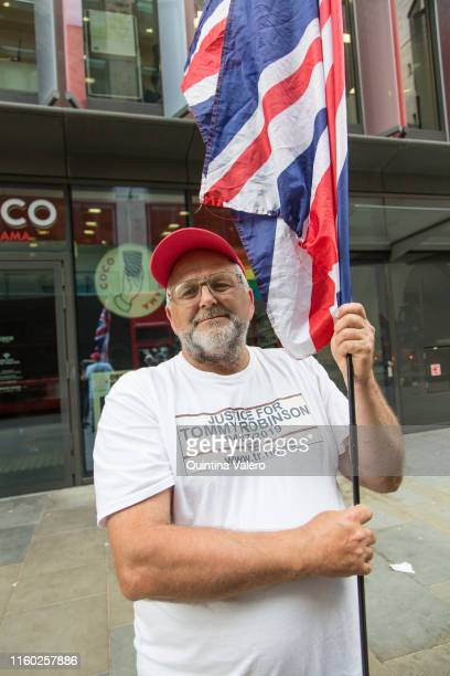 Keith Burguess from Cornwall supports Tommy Robinson outside the Old Bailey on July 5 2019 in London United Kingdom Stephen YaxleyLennon the former...