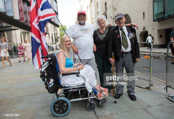 Keith Burguess from Cornwall Sylvi Mehnood from Croxley Green and veteran Jin Willoos from London supporters of Tommy Robinson outside the Old Bailey...