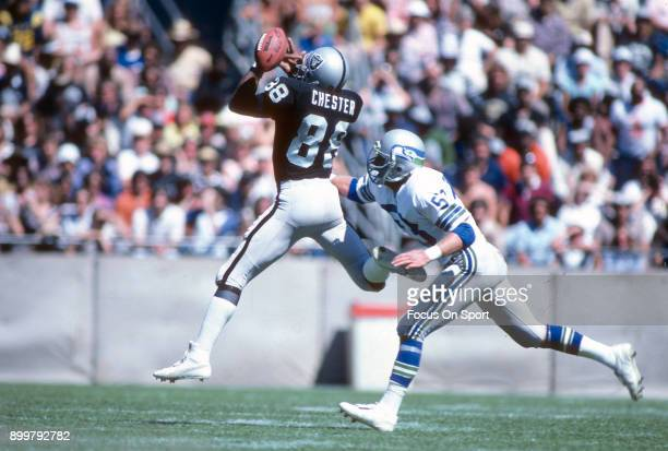 Keith Butler of the Seattle Seahawks breaks up this pass intended for Raymond Chester of the Oakland Raiders during an NFL Football game December 16...