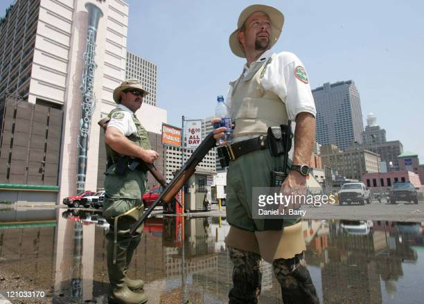 Keith Byrdleft and Buddy Brien from Tennessee Wildlife Resources Agency secure an area of downtown New Orleans Sunday September 42005
