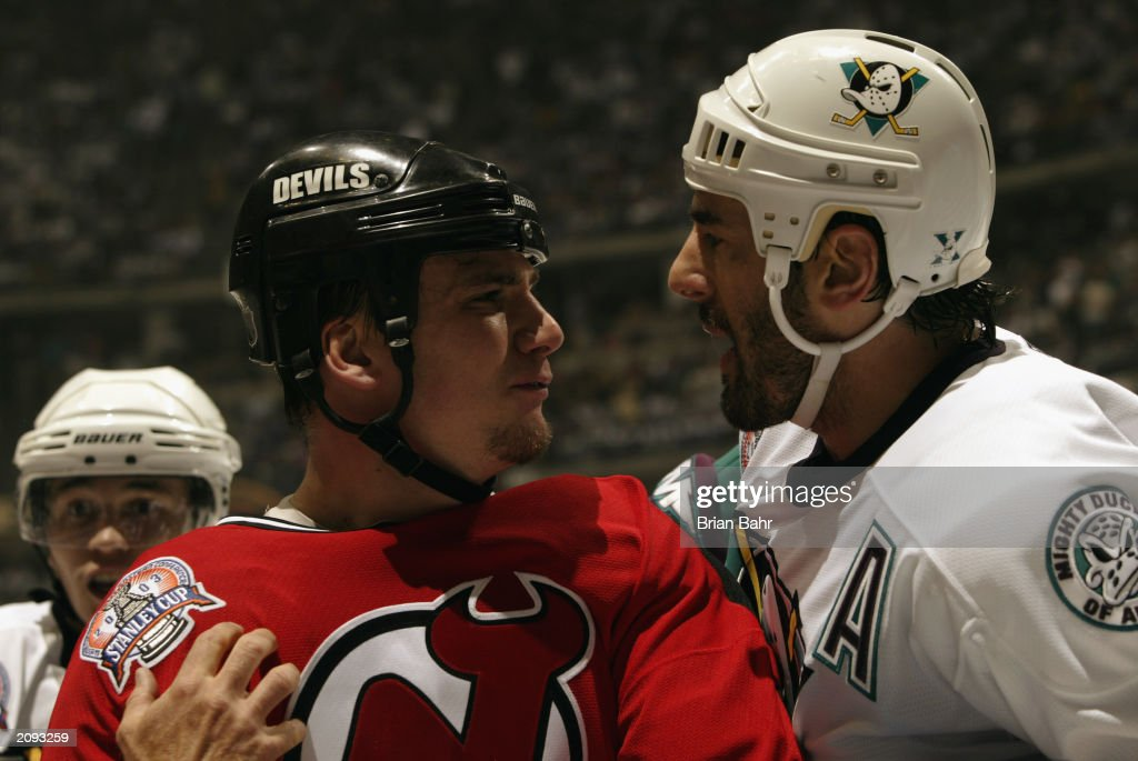 Keith Carney #3 of the Anaheim Mighty Ducks gets in the face of Jamie Langenbrunner #15 of the New Jersey Devils during Game Six of the 2003 Stanley Cup Finals at the Arrowhead Pond of Anaheim on June 7, 2003 in Anaheim, California. The Ducks won 5-2.