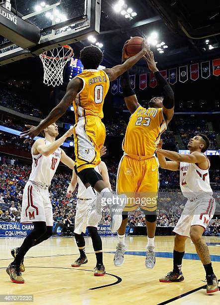 Keith Carter and Jubril Adekoya of the Valparaiso Crusaders grab a rebound during the second round of the Men's NCAA Basketball Tournament at...