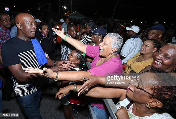 Keith Christopher Rowley , Prime Minister of Trinidad & Tobago, greets admirers in the audience at the semi-finals of Panorama in the Queen's Park...