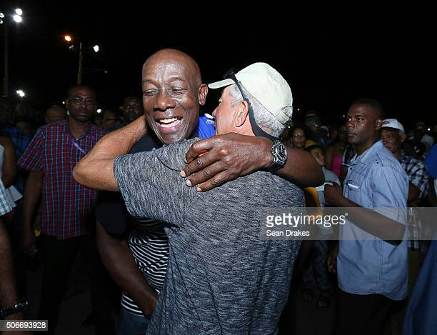 Keith Christopher Rowley , Prime Minister of Trinidad & Tobago, hugs an admirer at the semi-finals of Panorama in the Queen's Park Savannah during...