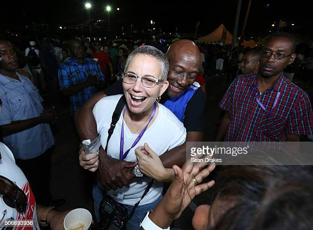 Keith Christopher Rowley , Prime Minister of Trinidad & Tobago, hugs Maria Nunes at the semi-finals of Panorama in the Queen's Park Savannah during...