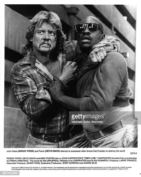 Keith David and Roddy Piper bloodied attempt to overcome alien forces in a scene from the Universal Studio movie 'They Live' circa 1988