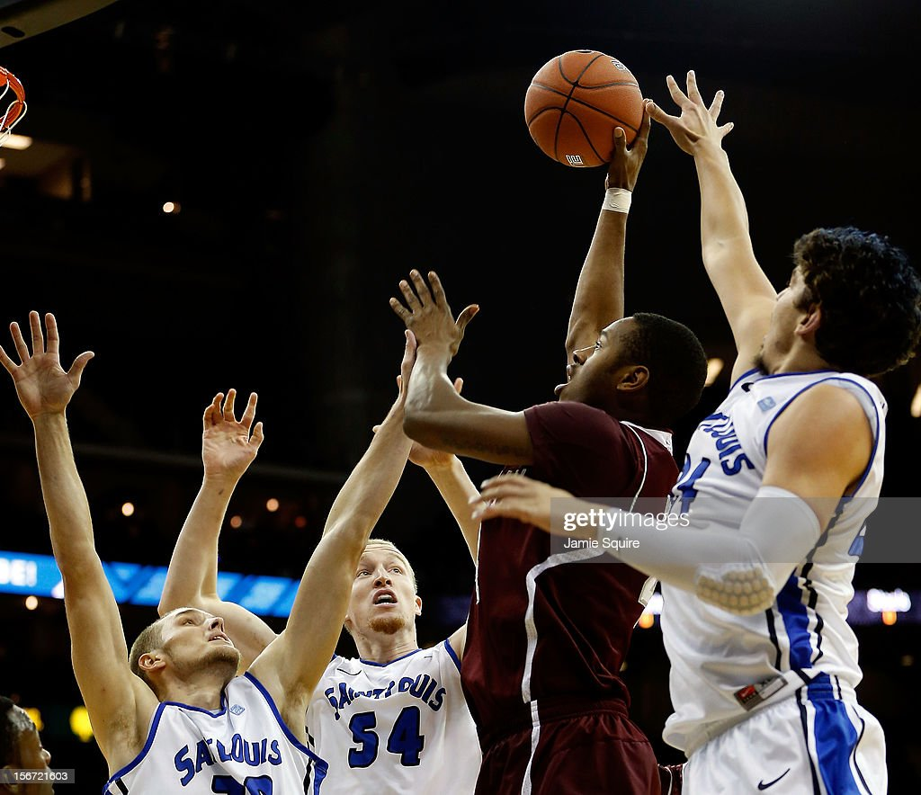 Keith Davis #4 of the Texas A&M Aggies shoots over Jake Barnett #30, John Manning #54, and Cody Ellis #24 of the Saint Louis Billikens during the CBE Hall of Fame Classic at Sprint Center on November 19, 2012 in Kansas City, Missouri.