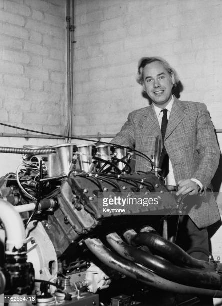 Keith Duckworth designer of the Ford Cosworth DFV V8 engine poses for a portrait with the magnesium engine at Cosworth Engineering on 3rd January...