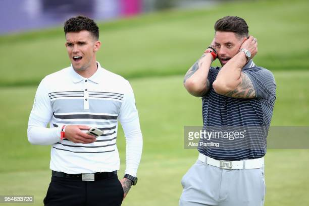 Keith Duffy and Gary Beadle react on the 6th green during the Pro Am event prior to the start of GolfSixes at The Centurion Club on May 4 2018 in St...