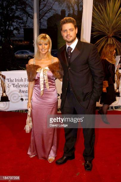 Keith Duffy and guest during The Irish Film and Television Awards 2004 Arrivals at The Burlington Hotel in Dublin Ireland