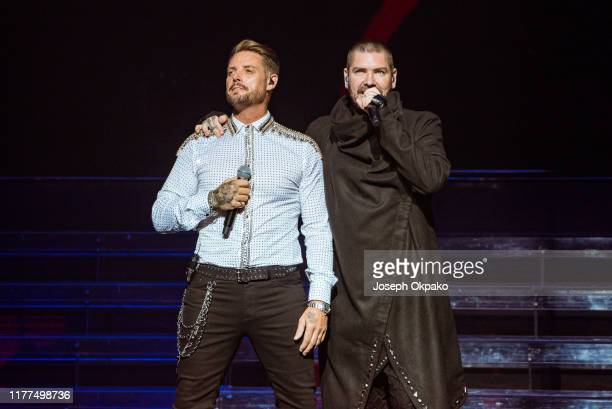 Keith Duffy and Shane Lynch of Boyzone perform on stage during The Final Five tour at the London Palladium on October 21 2019 in London England