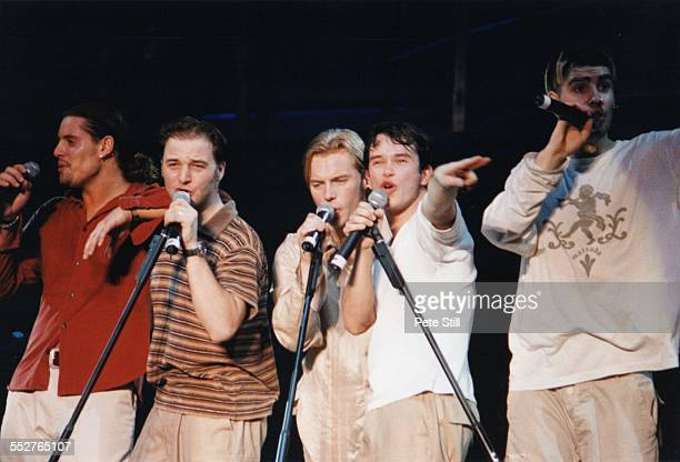 Keith Duffy Mikey Graham Ronan Keating and Stephen Gately of Boyzone perform on stage at Battersea Power Station on December 13th 1997 in London...