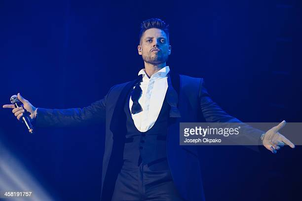Keith Duffy of Boyzone performs on stage at the Boyzone 20th Anniversary Tour 2013 at O2 Arena on December 20 2013 in London United Kingdom