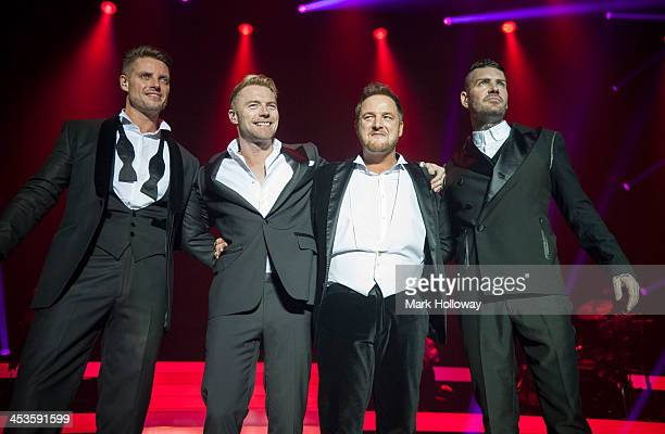 Keith Duffy Ronan Keating Mikey Graham and Shane Lynch of Boyzone performing on stage at BIC on December 4 2013 in Bournemouth United Kingdom