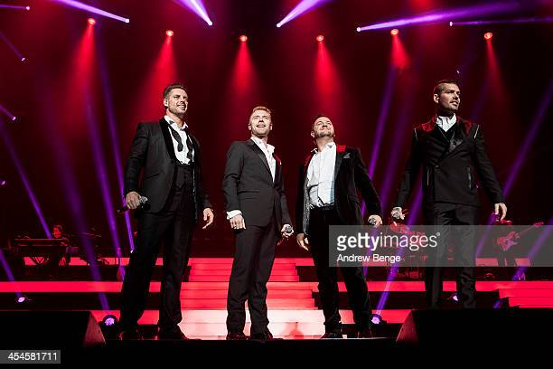 Keith Duffy Ronan Keating Mikey Graham and Shane Lynch of Boyzone perform on stage at First Direct Arena on December 9 2013 in Leeds United Kingdom