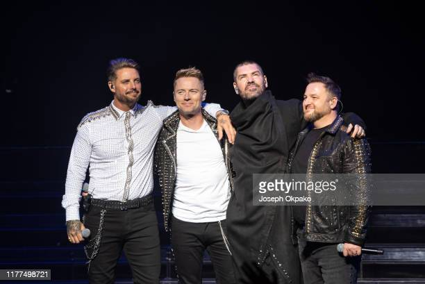 Keith Duffy Ronan Keating Shane Lynch and Mikey Graham of Boyzone perform on stage during The Final Five tour at the London Palladium on October 21...