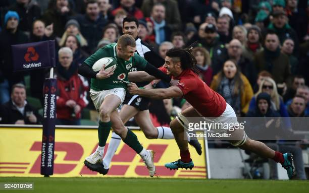 Keith Earls of Ireland and Josh Navidi of Wales during the Six Nations Championship rugby match between Ireland and Wales at Aviva Stadium on...