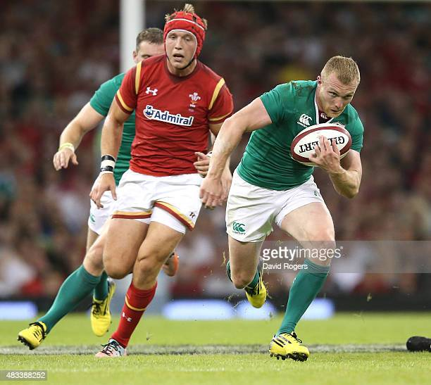 Keith Earls of Ireland breaks with the ball to score a try during the International match between Wales and Ireland at the Millennium Stadium on...