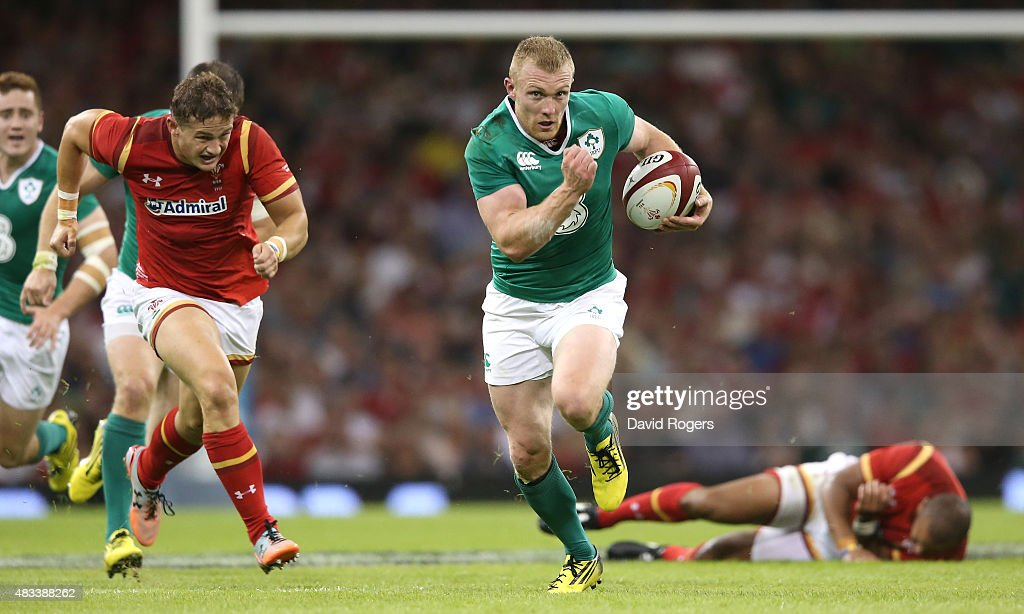 Keith Earls of Ireland breaks with the ball to score a try during the International match between Wales and Ireland at the Millennium Stadium on August 8, 2015 in Cardiff, Wales.