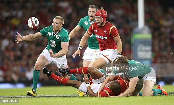 Keith Earls of Ireland catches the ball to score a try after Eli Walker is tackled by Andrew Trimble during the International match between Wales and...