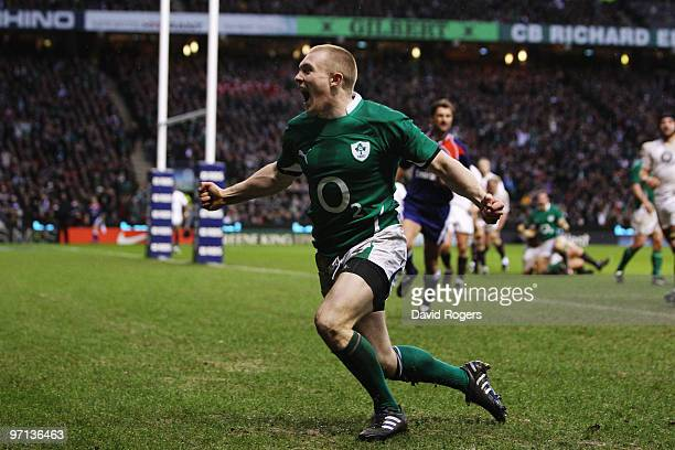Keith Earls of Ireland celebrates as he scores their second try during the RBS Six Nations match between England and Ireland at Twickenham Stadium on...