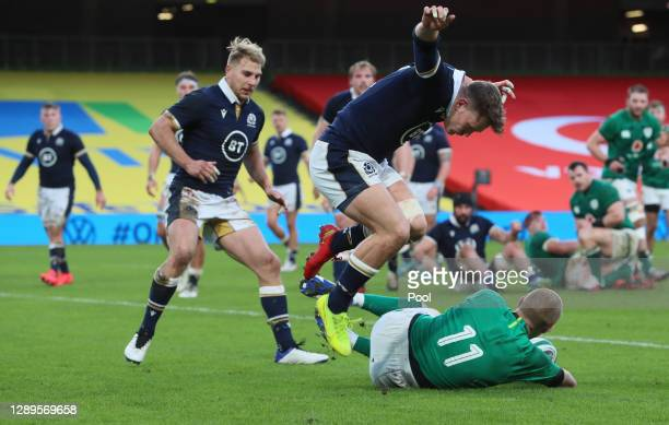 Keith Earls of Ireland goes over to score their sides first try during the Autumn Nations Cup match between Ireland and Scotland at Aviva Stadium on...