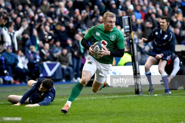 Keith Earls of Ireland scores his sides third try during the Guinness Six Nations match between Scotland and Ireland at Murrayfield on February 9...