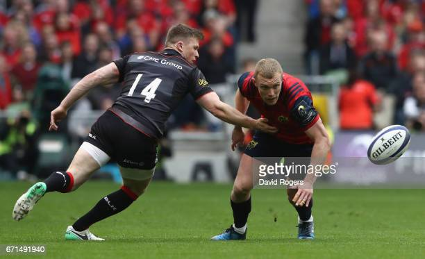 Keith Earls of Munster attempts to gather the ball as Chris Ashton challenges during the European Rugby Champions Cup semi final match between...