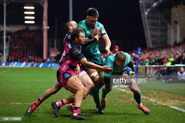 Keith Earls of Munster dives in to score a try during the Champions Cup match between Gloucester Rugby and Munster Rugby at Kingsholm Stadium on...