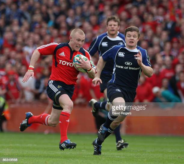Keith Earls of Munster races away from Brian O'Driscoll during the Heineken Cup semi final match between Munster and Leinster at Croke Park on May 2,...