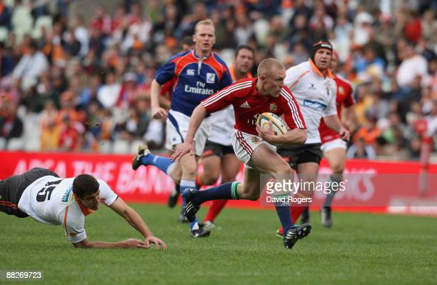 Keith Earls of the Lions races away to score the second try during the match between the Cheetahs and the British and Irish Lions on their 2009 tour...