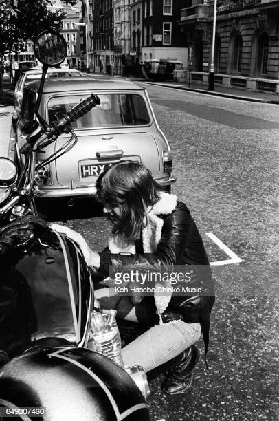 Keith Emerson maintains his favorite Kawasaki bike, August 1974.