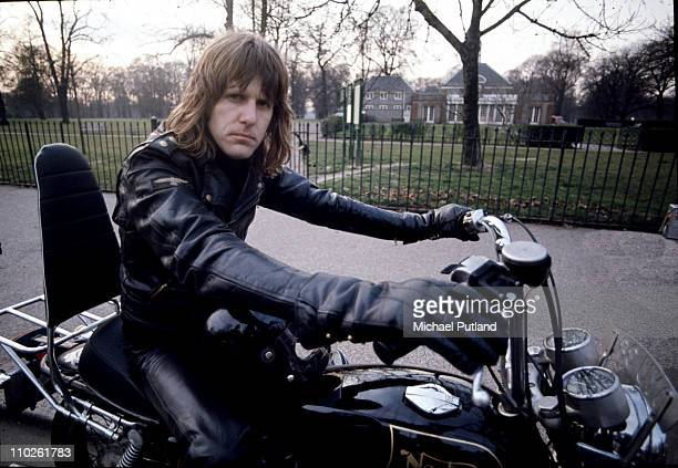 Keith Emerson of Emerson Lake and Palmer, portrait riding a Norton motorcycle, London, circa 1972.