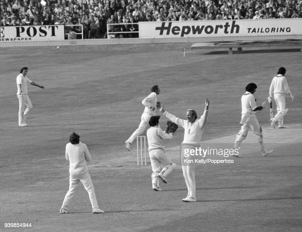 Keith Fletcher of England celebrates after taking the catch to dismiss Pakistan batsman Sarfraz Nawaz to close Pakistan's 2nd innings of the 1st Test...