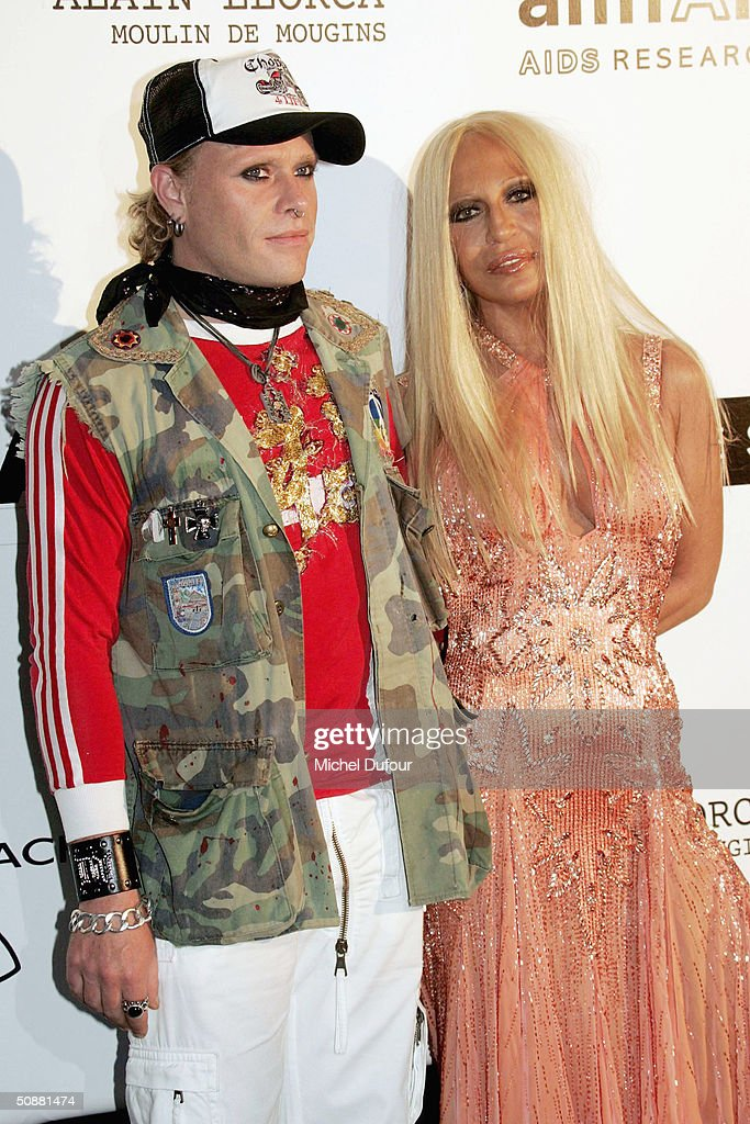 Keith Flint and Donatella Versace arrive at 'Cinema Against AIDS 2004', the 11th annual event in aid of amfAR (American Foundation for AIDS Research) at Le Moulin de Mougins at the 57th Cannes Film Festival on May 20, 2004 in Cannes, France.