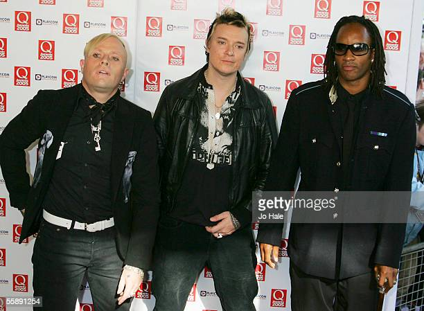 Keith Flint Liam Howlett Maxim Reality of the band Prodigy arrive at the Q Awards the annual magazine's music awards at Grosvenor House on October 10...