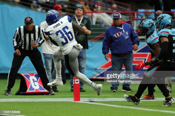 Keith Ford of the St Louis Battlehawks scores a touchdown against the Dallas Renegades in the second quarter during an XFL game on February 09 2020...