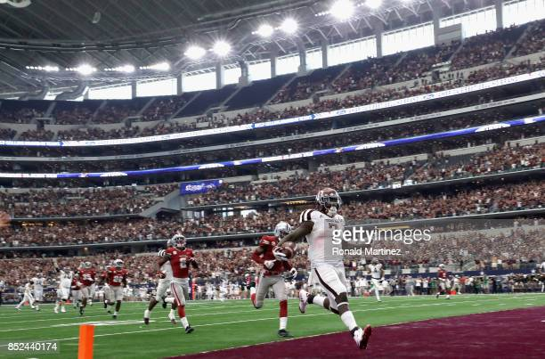 Keith Ford of the Texas A&M Aggies runs for a touchdown in the fourth quarter against the Arkansas Razorbacks at AT&T Stadium on September 23, 2017...