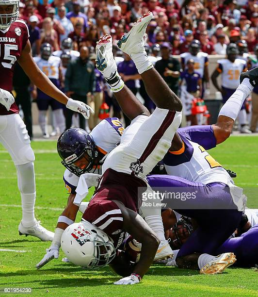 Keith Ford of the Texas A&M Aggies scores on an 11 yard run against the Prairie View A&M Panthers in the \first quarter at Kyle Field on September...