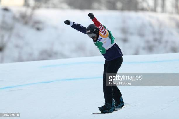 Keith Gabel of USA celebrates winning his semi final against Gurimu Narita of Japan during the Men's Snowboard Cross SBLL2 during day three of the...