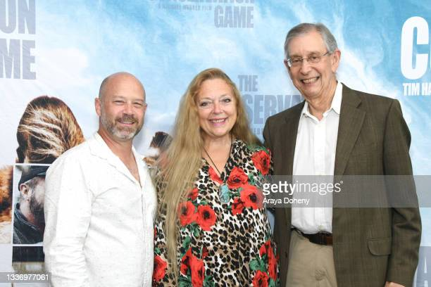 """Keith Gad, Carole Baskin and Howard Baskin attend the Los Angeles theatrical premiere of """"The Conservation Game"""" on August 28, 2021 in Santa Monica,..."""